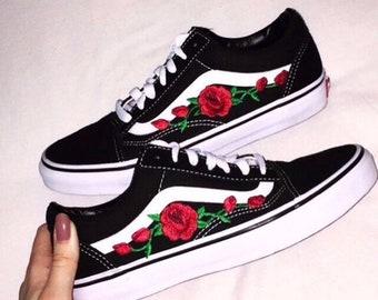 Trova > vans old skool nere con le rose |