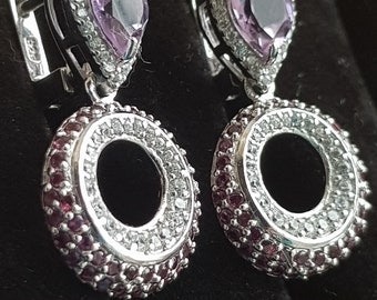 White gold coated silver earrings with white CZ, purple ametyst and rhodilite garnet.