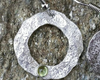 Silver with peridot, hand-hammered earrings. Stainless steel ear wire.