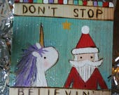 Unicorn Santa Christmas ornament Wood burned NURSERY ART wall hanging Don't stop BELIEVIN' song lyrics