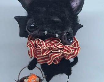 Bruce the Bat with a bucket of pumpkins
