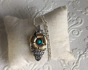 Turquoise and brass mixed metal flower pendant