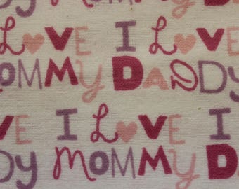 """I love Mommy  I love Daddy Pinks Lavender on white 100% cotton flannel  41""""-44"""" wide"""
