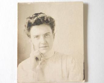 1910's Vintage Black and White Photograph •  Woman with Up-swept Hair Photo