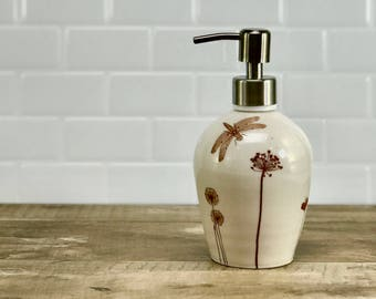 White porcelain soap dispenser/ ceramic soap dispenser/ lotion dispenser with wildflowers, a dragonfly and a brushed nickel pump