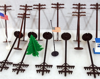 Lot of Model Railroad Items - 13 Electric or Telephone Poles - 5 are Marx - 2 American Flags - Tree, Phone Booth