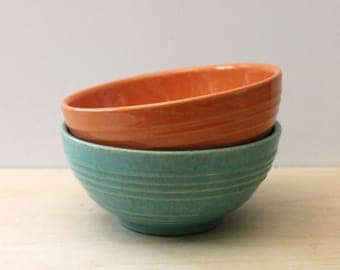 Vintage ringware bowls in orange and jade green.