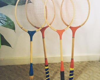 Set of four bamdminton/squash rackets