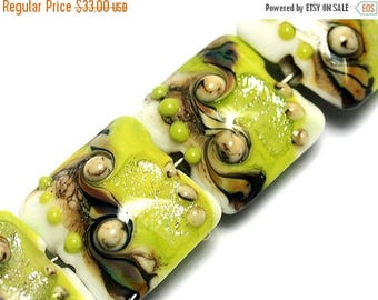 ON SALE 35% OFF Glass Lampwork Bead Set - Four Lime Stardust Pillow Beads 10505614