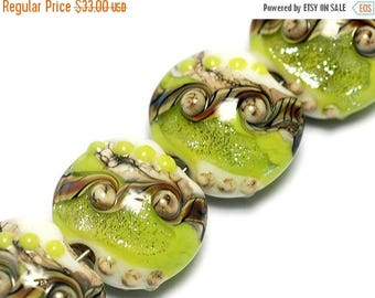 ON SALE 30% off Glass Lampwork Bead Set - Four Lime Stardust Lentil Beads 10505612