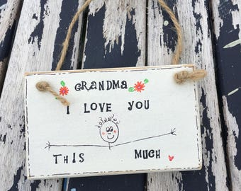 Handmade Plaque for Grandma with pretty flowers and a string hanger.  Rustic and lovely!