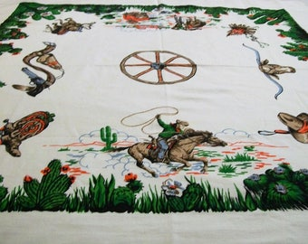Vintage Cowboy Tablecloth, Western Style Tablecloth. Vintage Tablecloth, Cowboys riding horse, table linens, wagon wheel