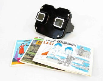 Vintage View-master in Black with 12 Reels. Circa 1950's.