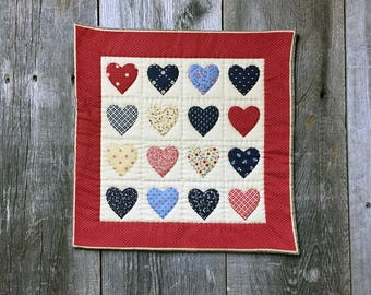 vintage fabric red with multi colored hearts hand quilted table mat, center piece, wall hanging    you decide its use!