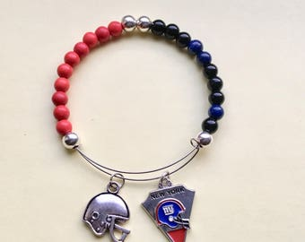 "New York Giants memory wire charm bracelet expandable 2 1/2 "" diameter fits 7 1/2 - 8 inch wrist."