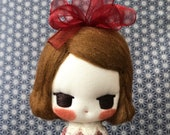 Little dolly with  red bow