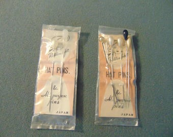 Two packages of NOS Hatpins