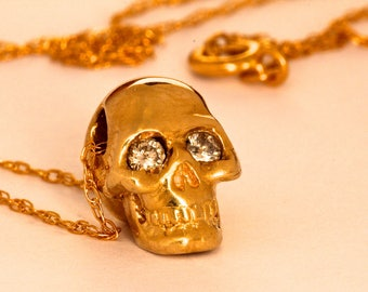 Solid Gold Tiny diamond eyed human skull pendant made in NYC Blue Bayer Design