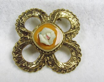 Porcelain rose epoxy enamel hurricane brooch pin.
