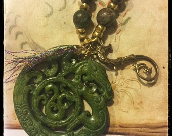 All Souls Trilogy Necklace -Corra in vintage carved green jade &vintage bronze charm.Diana's weaver hand and her colors. Bloodstone beads...
