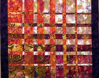 Quilted Batik Convergence Wall Hanging purple crimson cream