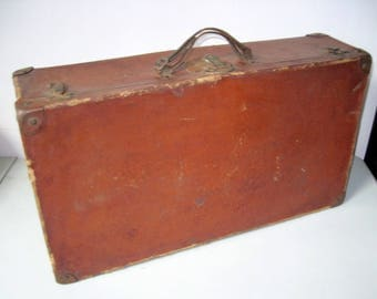 Vintage cardboard suitcase with leather handle