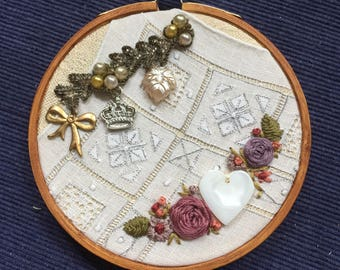 Embroidered Collage Hoop with vintage textiles, charms, trim, button, upcycled art
