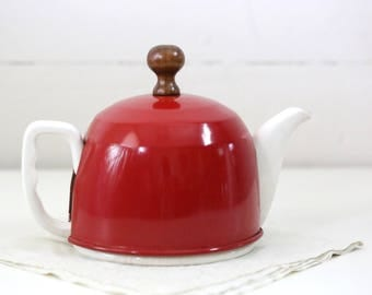 LIttle teapot with wool cover and red aluminum hood