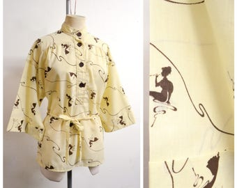 1970s Novelty smoking lady print cream & brown tunic blouse / 70s does 40s cigarette pipe smoke printed tea timer top - M L