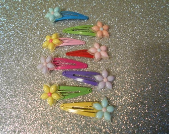 Choice of five point different color flower flat back on snap clip #60010