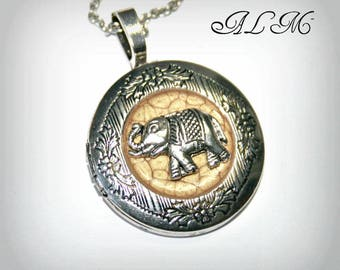 Locket necklace with elephant and background antique gold
