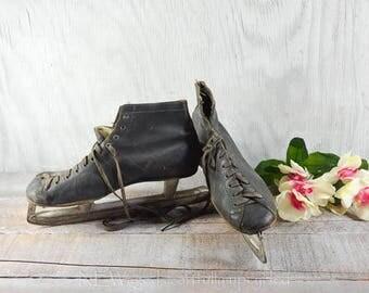 Antique ice skates, old leather ice skates, rustic decor