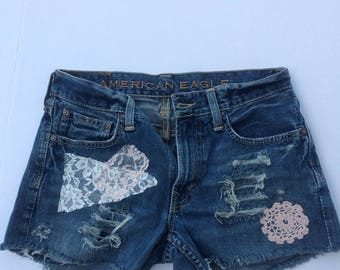 patched denim, short shorts, daisy dukes, cut off shorts, grunge wear, distressed, hippie festival, beach shorts, size 28