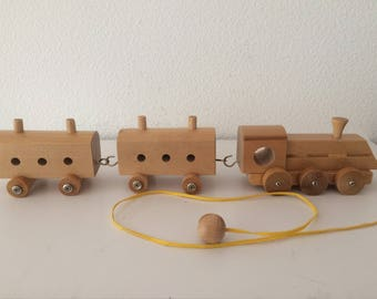 Vintage wooden train set with one locomotive and two carriages, made in the USSR