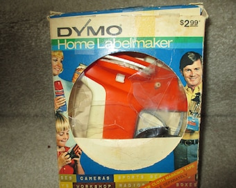 Vintage DYMO label maker embossing tapewriter and labeling tape in original packaging