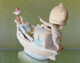 Tabletop sculpture, Venetian Dream, fish head gondolier and dreamer china assemblage