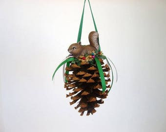 Ornament, pine cone ornament, decorated pine cone with ceramic squirrel