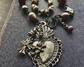 RESERVED: Sacred heart, milagro necklace | ex voto necklace, Milagros necklace, amulet necklace, assemblage necklace, heart Milagros