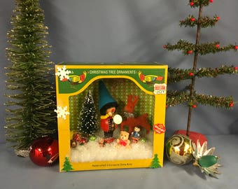 Vintage Christmas holiday assemblage diorama using mid century ornaments and decorations