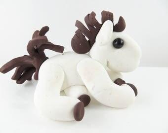 Clay white horse sculpture figurine