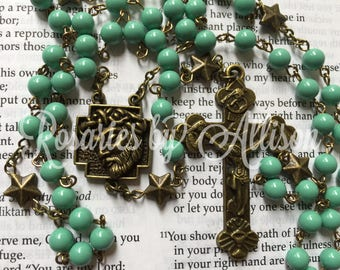 Jade Swarovski crystal pearl and brass star bead rosary with bronze plated Holy Face centerpiece and crucifix