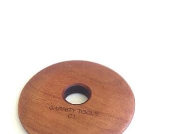 Round throwing rib, Wood pottery tool; C1