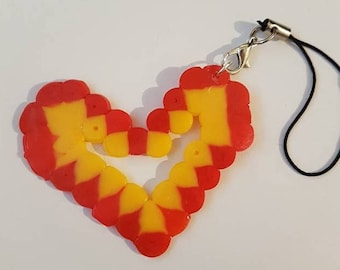 Red and yellow heart charm