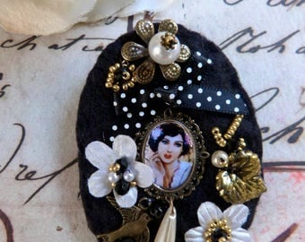 Oval retro textile brooch with a medallion, black and white.