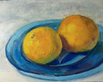 Oranges on blue plate