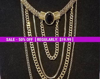 Pretty unique chain necklace with multiple chain dangles. Good vintage condition. Rare style.