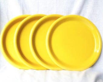 Four vintage Crown Corning plates...yellow luncheon plates...Japan.