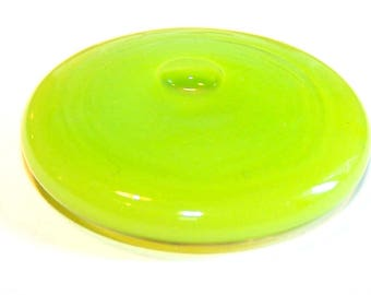 A globe round 34 mm lime green OPAQUE liquid filled glass