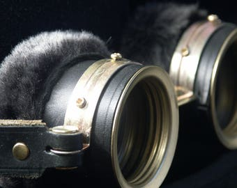 Steampunk goggles in black leather and brass with fur trimming.