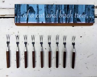 Set of 9 teak cocktail forks